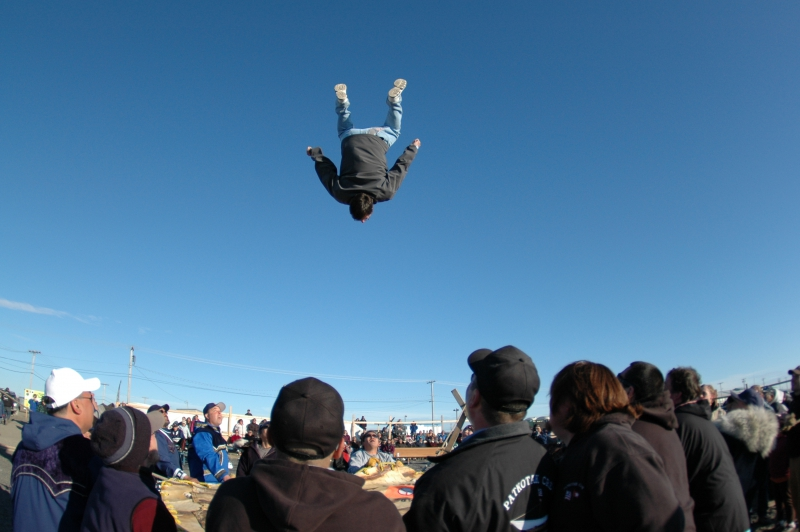 A man does an impressive flip on the blanket toss at the site of Nalukataq in Barrow, Alaska.