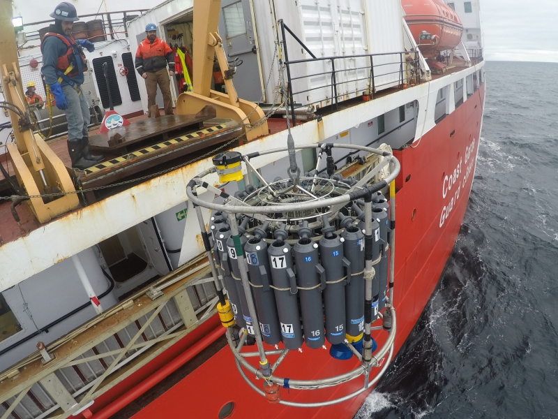 The CTD (conductivity, temperature, and depth) rosette is lowered into the ocean. Aboard the CCGS Louis S. St-Laurent in the Beaufort Sea.