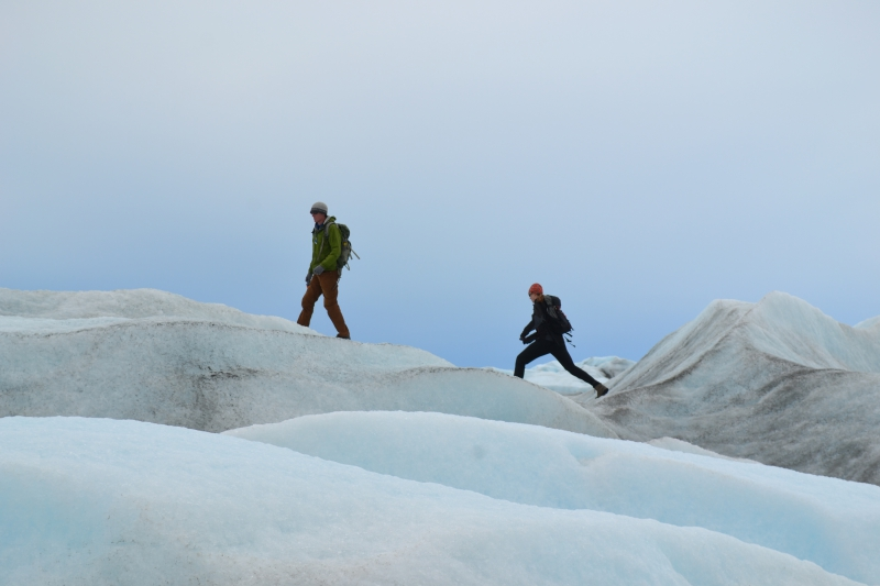 Brandon Strellis and Hannah James walk on the edge of the Greenland Ice Sheet. Kangerlussuaq, Greenland.Credit to read: Photo by Kevin McMahon (PolarTREC 2011), Courtesy of ARCUS