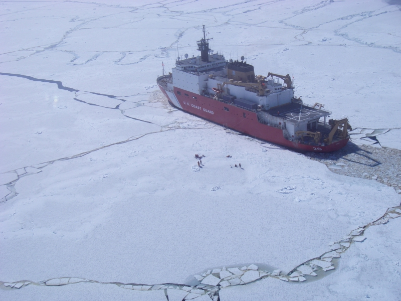 An aerial view of the USCGC Healy icebreaker, on the Bering Sea, from the helicopter.