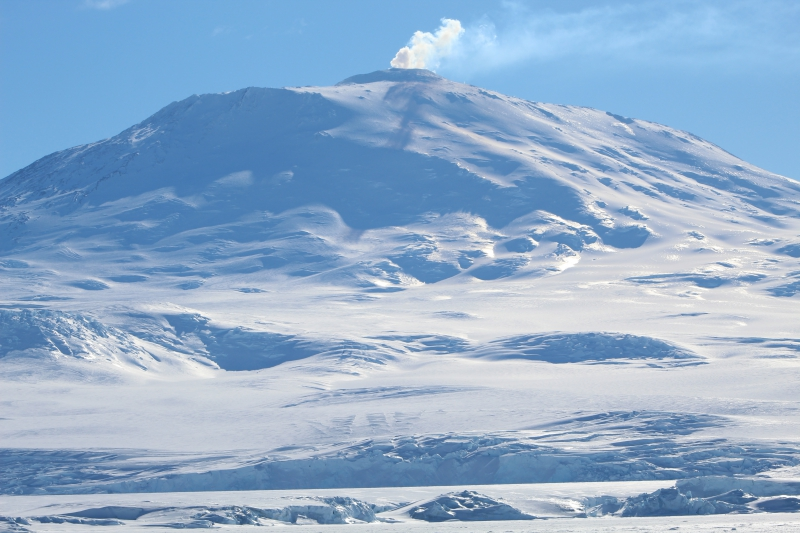 Mount Erebus (12,448 ft) vents on a sunny day, as seen from Hutton Cliffs, Antarctica.